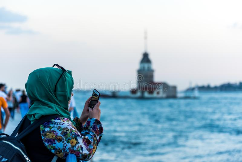 Tourists taking pictures at the Corniche park at Uskudar, Istanbul, Turkey, on the Anatolian shore of the Bosphorus.  royalty free stock image