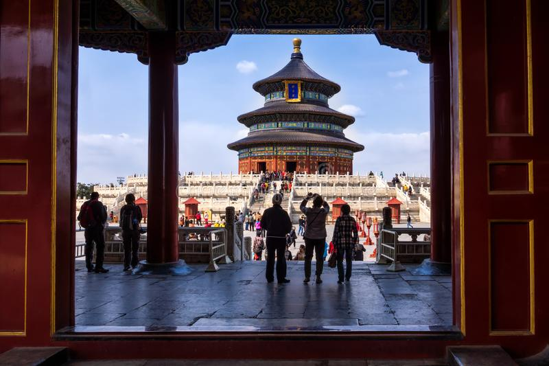 Tourists taking pictures in front of Temple of Heaven, view through open gate. Beijing royalty free stock image