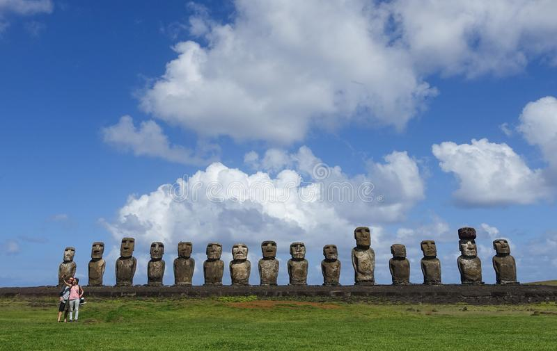 Tourists taking a selfie in front of Ahu Tongariki, Easter Island, Chile royalty free stock image