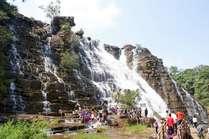 Tourists at Teerathgarh Waterfalls, Central India. Tourists enjoying at Teerathgarh Waterfalls located in Chattisgarh, India stock photo