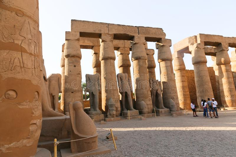 Tourists at Temple of Luxor - Egypt. Day view of Luxor Temple Luxor, Egypt royalty free stock images