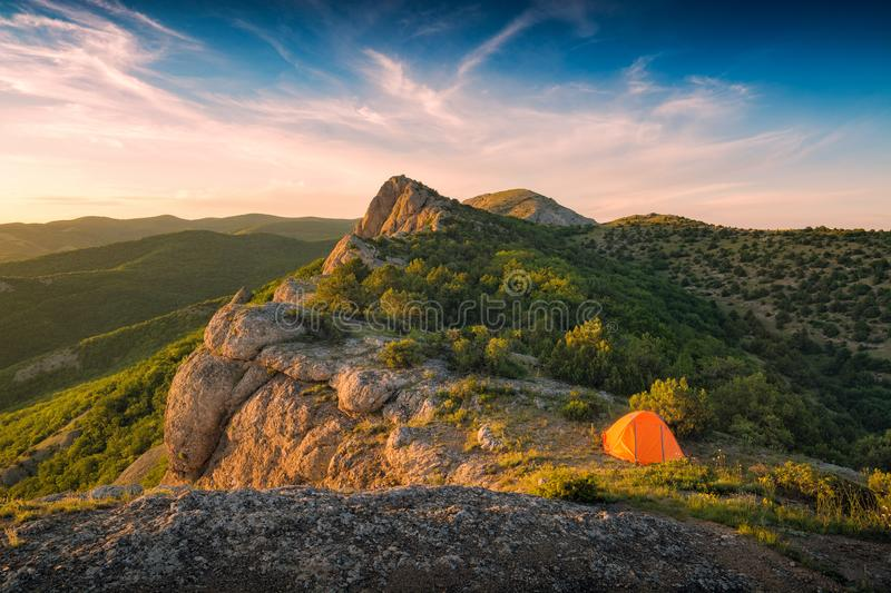 Tourists tent on the edge of rocky hill stock photography