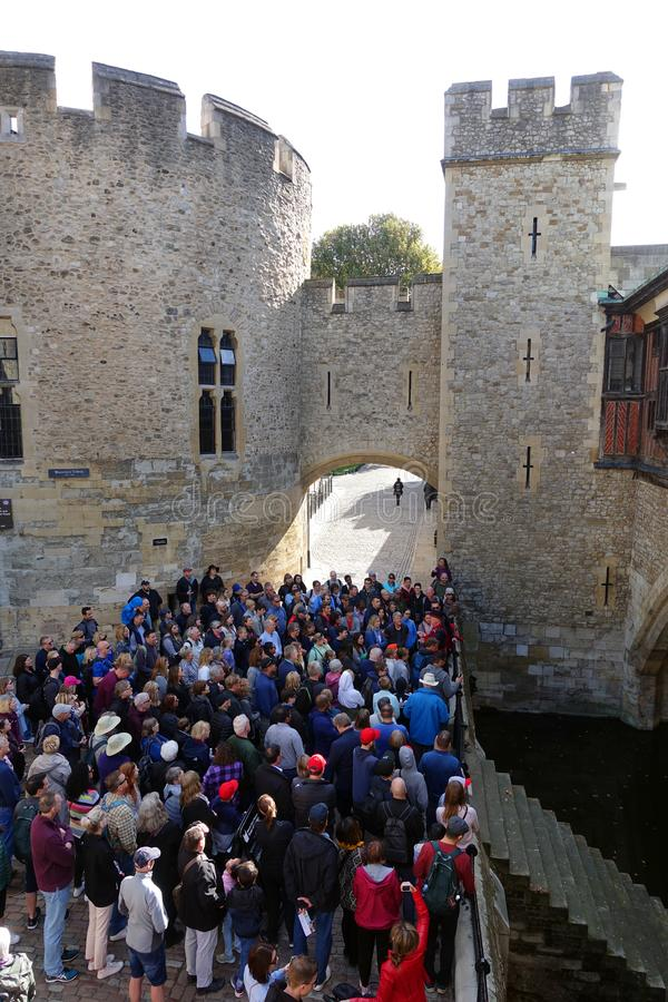 Tourists at Traitors' Gate, Tower of London, England stock image