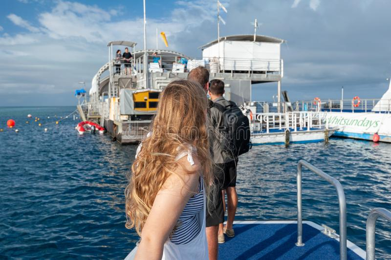 Tourists on transfer boat to Reef World on Great Barrier reef. Hook Reef, Great Barrier Reef, Queensland, Australia - July 15 2018: Tourists on transfer boat to royalty free stock photography
