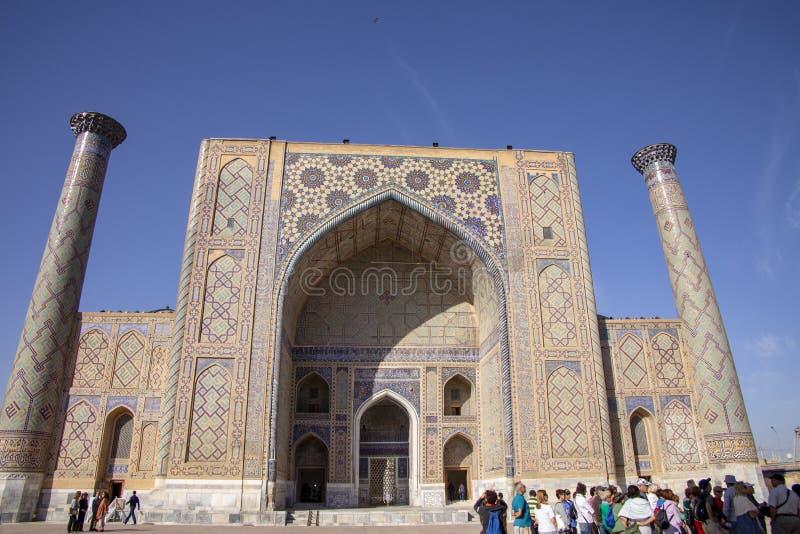 Tourists at Ulug Beg Madrasa, The Registan, Samarkand, Uzbekistan stock photo