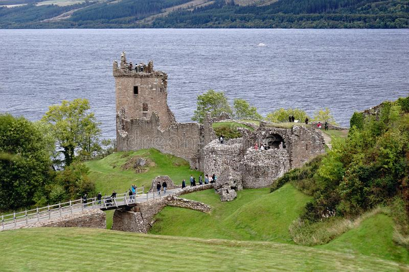 Tourists at Urquhart Castle by Loch Ness, Scotland royalty free stock photos