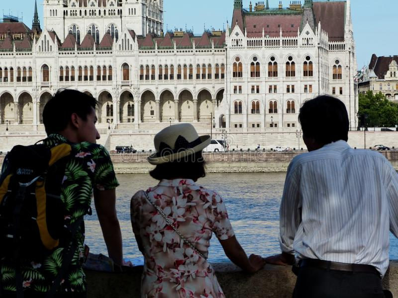 Tourists viewing the Budapest panorama and the Parliament by the Danube stock photos