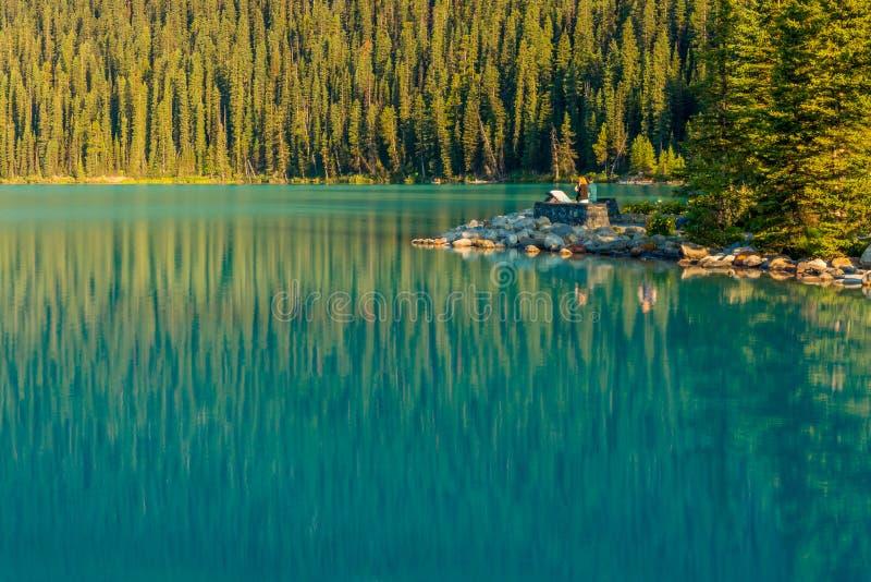 Tourists viewing Lake Louise Banff National Park stock image