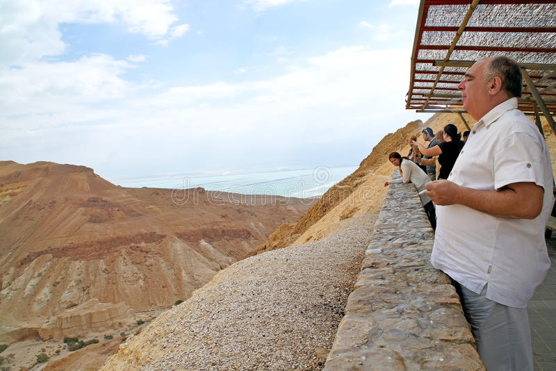Tourists on viewing platform overlooking Dea. Tourists on a viewing platform overlooking the Dead Sea in Israel on 14.05.2011 stock photos