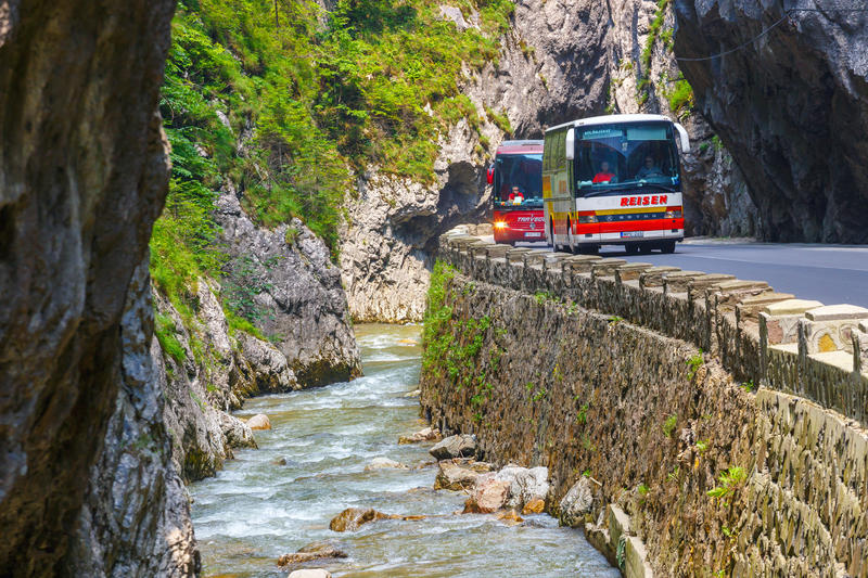 Tourists visit the Bicaz Canyon. Canyon is one of the most spectacular roads in Romania. BICAZ GORGES, ROMANIA - JULY 07, 2015 : Tourists visit the Bicaz Canyon stock photography