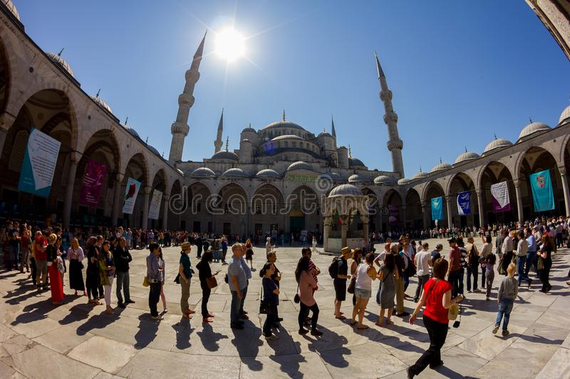 Tourists visit in the Blue Mosque Sultanahmet. Long queue of people for ticket. royalty free stock image