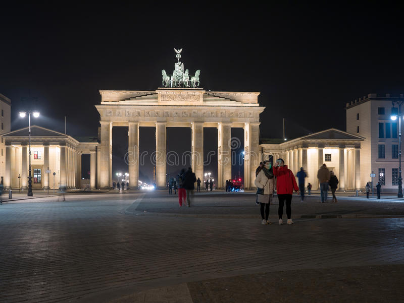 Tourists visit Brandenburger Tor in Berlin at night royalty free stock photos