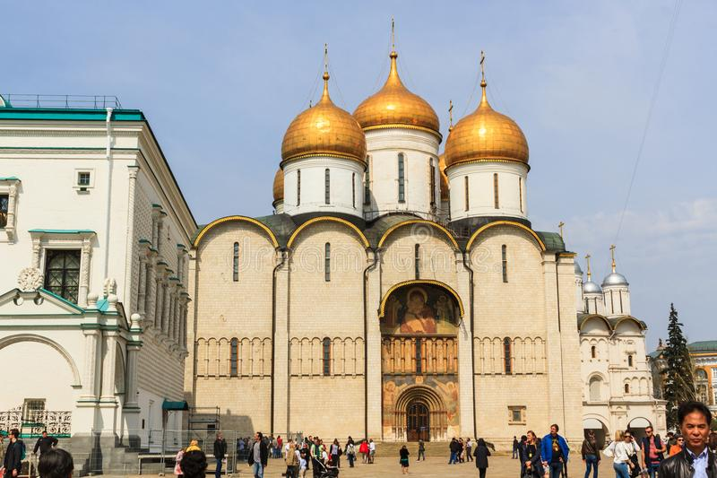 Tourists visit The Cathedral of the Dormition is the largest church in the Moscow Kremlin, Russia. stock photography