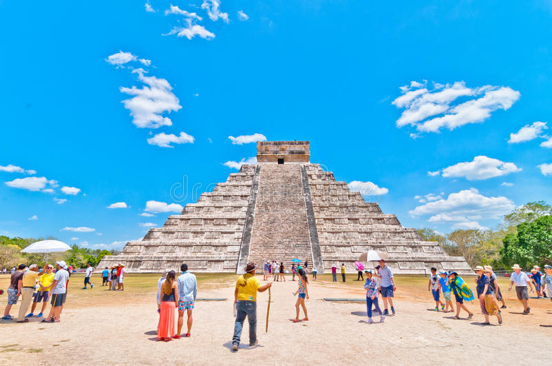Tourists visit Chichen Itza - Yucatan, Mexico. CHICHEN ITZA, MEXICO - APRIL 20, 2014: tourists visit Chichen Itza, one of the most visited archaeological sites royalty free stock images