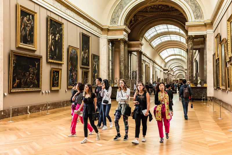 Tourists visit the Louvre Museum Musee du Louvre. Paris, Franc royalty free stock photo