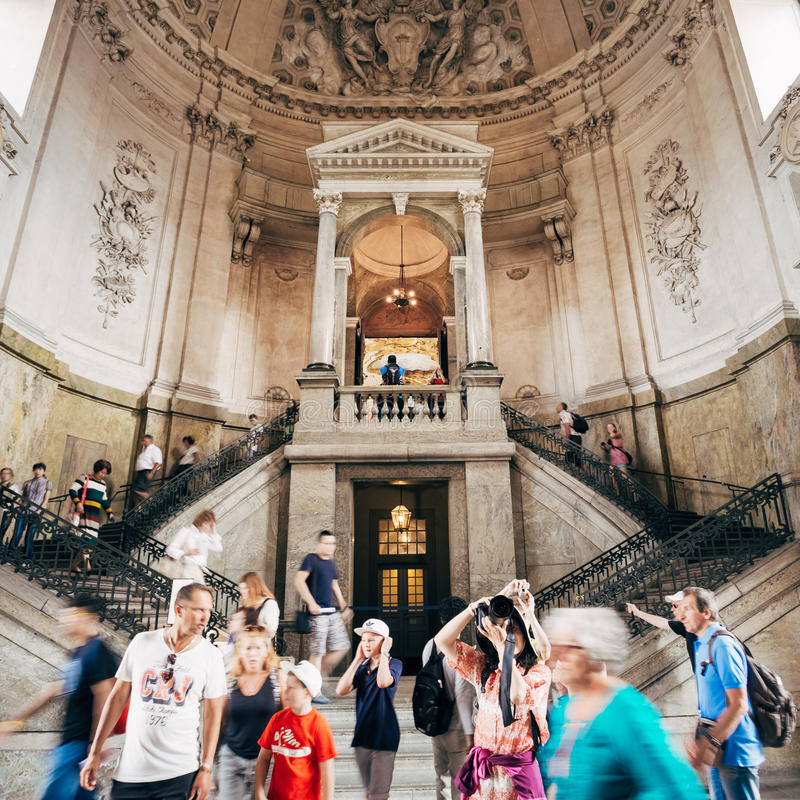 Tourists visit and photograph at the Royal palace royalty free stock image