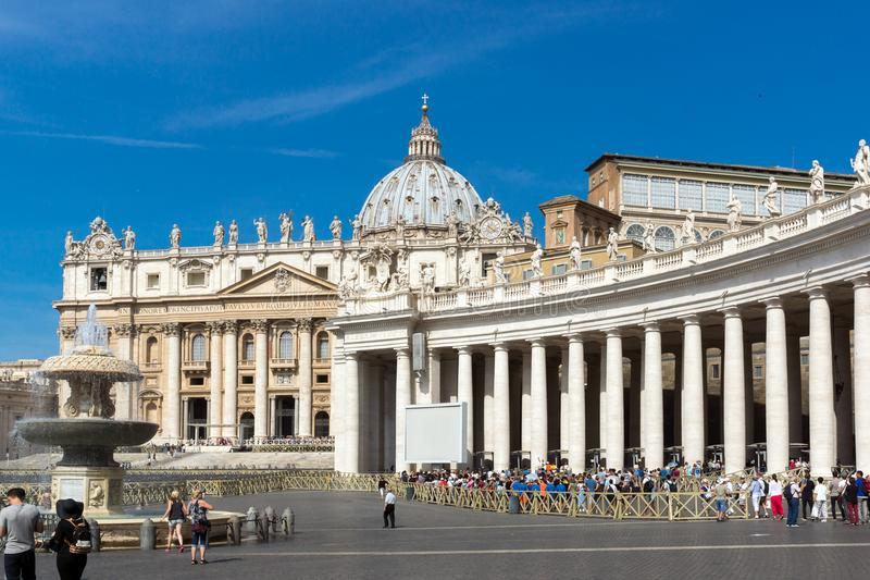 Tourists visit Saint Peter`s Square and St. Peter`s Basilica in Rome, Vatican, Italy stock photo