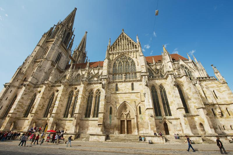 Tourists visit square in front of the St. Peter Cathedral in Regensburg, Germany. royalty free stock photography