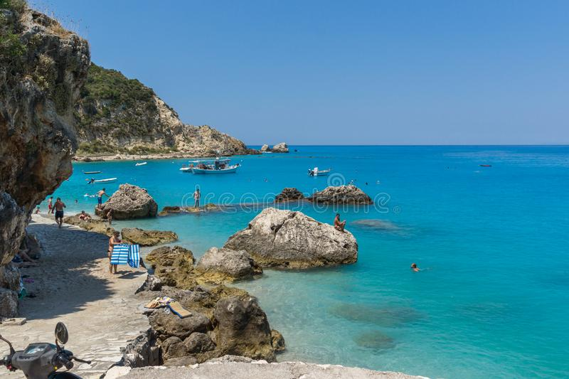 Tourists visiting beach of village of Agios Nikitas, Lefkada, Ionian Islands, Gree stock images