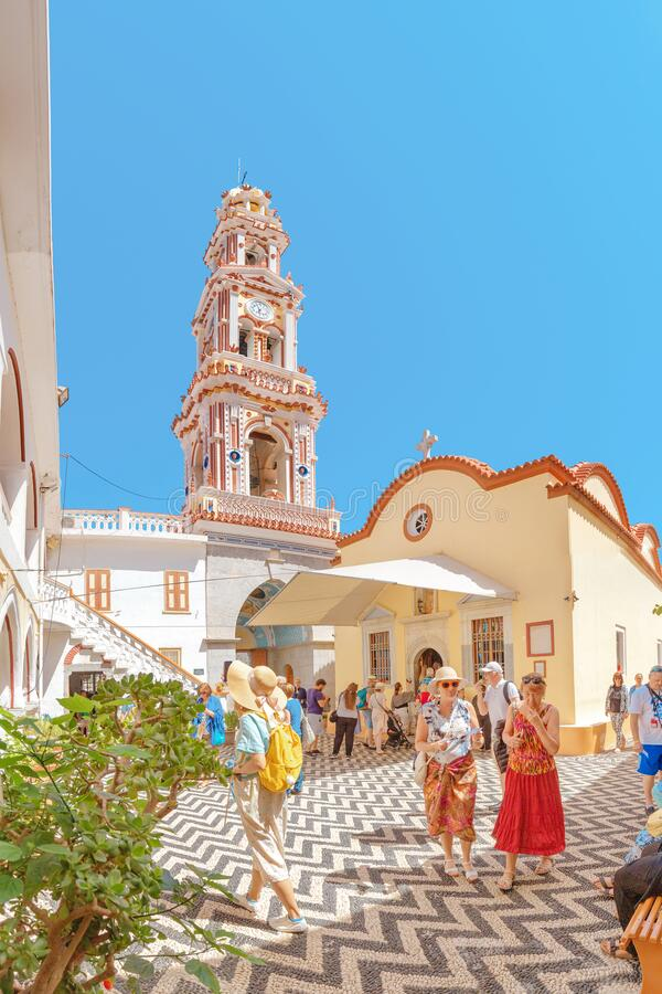Tourists visiting famous monastery Panormitis on the island of Symi, Greece. Dodecanese stock photo