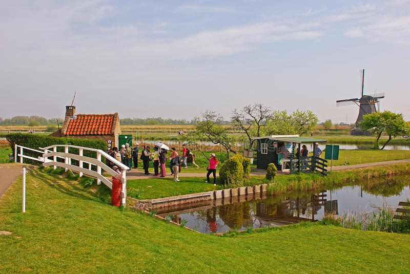 Tourists visiting the famous windmill at Kinderdijk, the Netherlands royalty free stock image