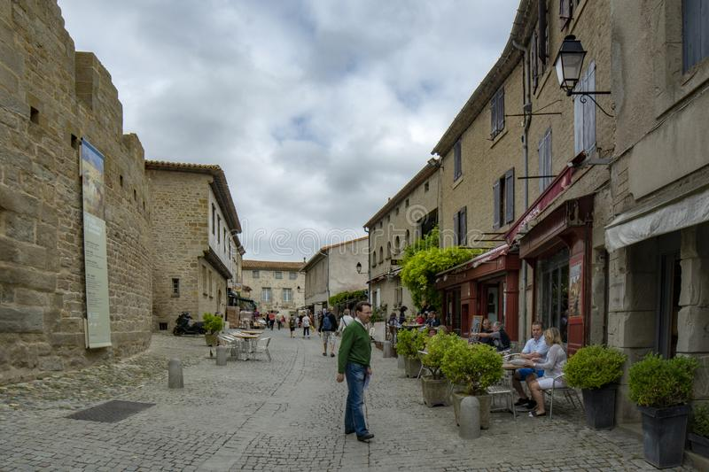 Tourists visiting the fortified medieval city of Carcassonne, France royalty free stock image