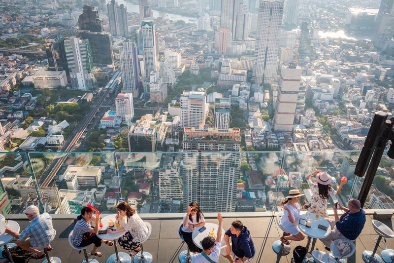 Tourists at King Power Mahanakorn Building at 78th floor roof top in Bangkok, Thailand. royalty free stock photography