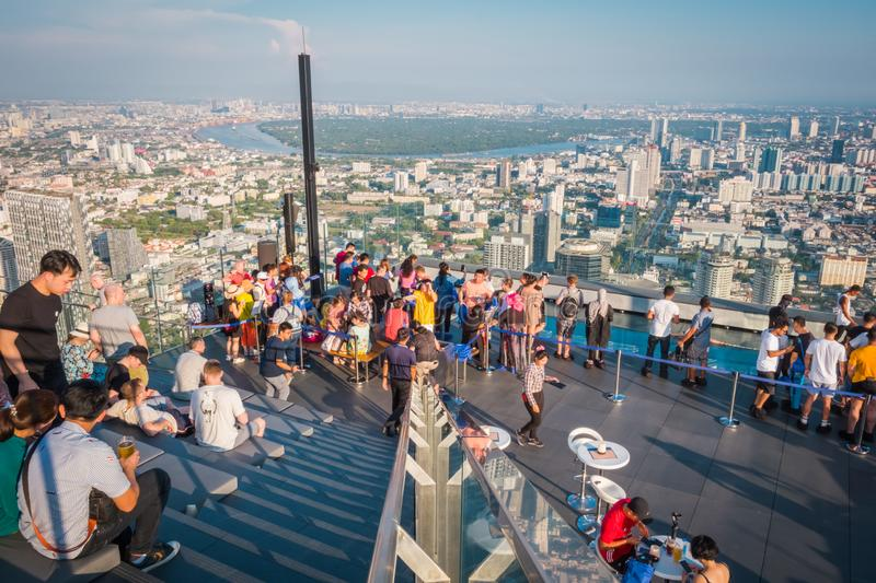Tourists at King Power Mahanakorn Building at 78th floor roof top in Bangkok, Thailand. stock photography