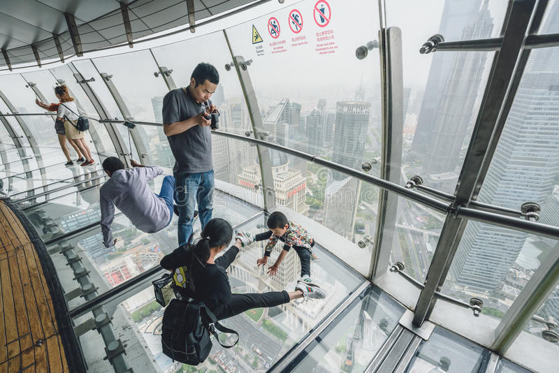 Tourists visiting Oriental Pearl Tower in Shanghai, China. SHANGHAI, CHINA - MAY 07, 2016: Tourists visiting Oriental Pearl Tower. With 470 meter it is one of stock photos