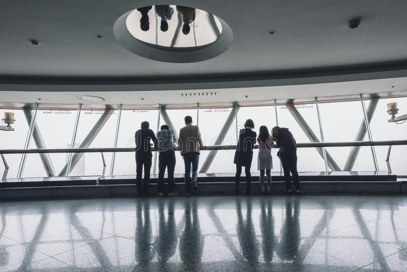 Tourists visiting Oriental Pearl Tower in Shanghai, China royalty free stock images