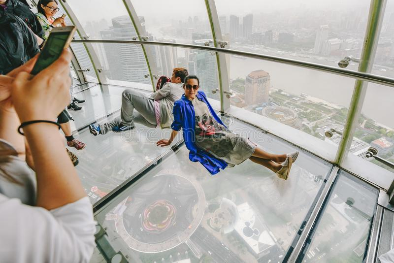Tourists visiting Oriental Pearl Tower in Shanghai, China. SHANGHAI, CHINA - MAY 07, 2016: Tourists visiting Oriental Pearl Tower. With 470 meter it is one of royalty free stock images