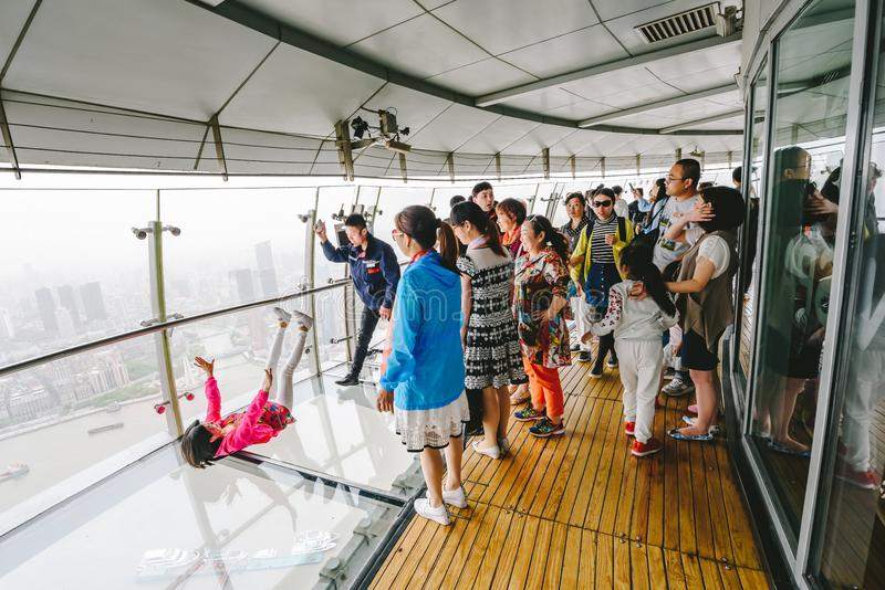 Tourists visiting Oriental Pearl Tower in Shanghai, China. SHANGHAI, CHINA - MAY 07, 2016: Tourists visiting Oriental Pearl Tower. With 470 meter it is one of stock photography