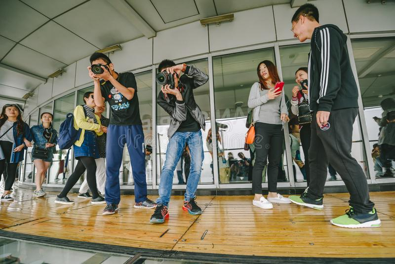 Tourists visiting Oriental Pearl Tower in Shanghai, China. SHANGHAI, CHINA - MAY 07, 2016: Tourists visiting Oriental Pearl Tower. With 470 meter it is one of royalty free stock image