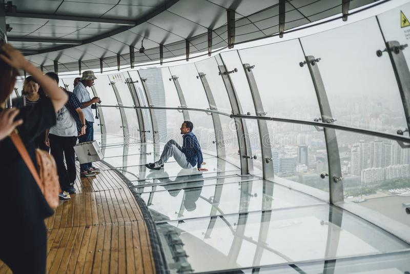 Tourists visiting Oriental Pearl Tower in Shanghai, China. SHANGHAI, CHINA - MAY 07, 2016: Tourists visiting Oriental Pearl Tower. With 470 meter it is one of stock images
