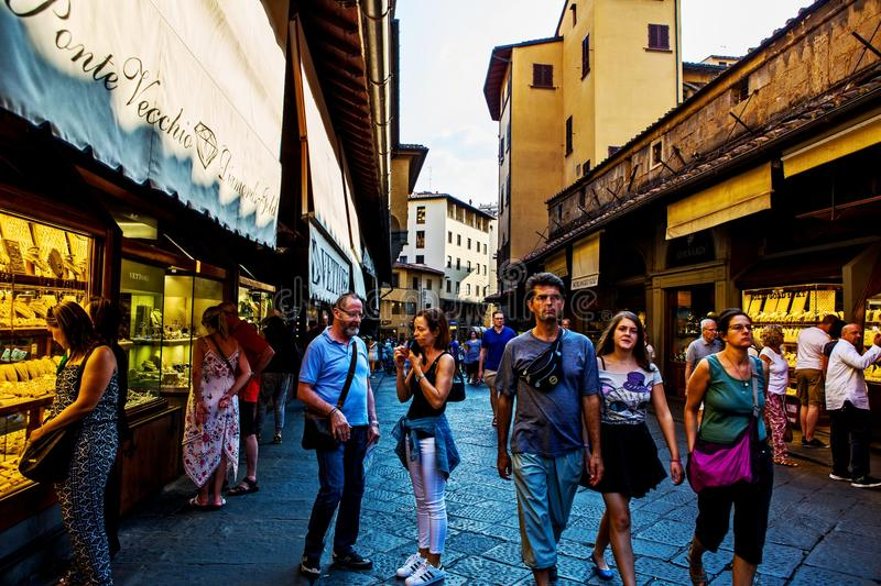 People visiting Ponte Vecchio in Florence. Tourists visiting Ponte Vecchio, old bridge, in Florence, Italy royalty free stock images