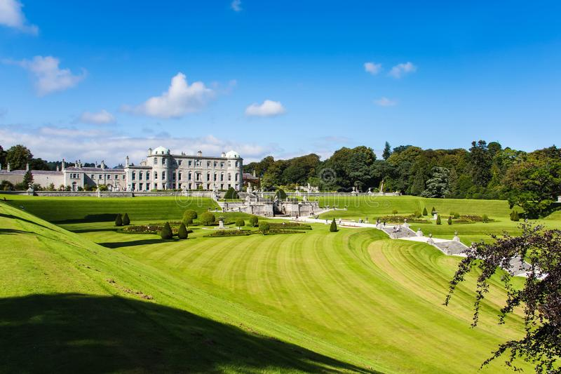 Tourists visiting Powerscourt Gardens, view on mansion from terraced lawn. Tourists visiting Powerscourt Gardens one of the most beautiful gardens in Ireland stock photos