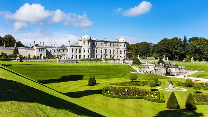 Tourists visiting Powerscourt Gardens, view on mansion from hill. Tourists visiting Powerscourt Gardens one of the most beautiful gardens in Ireland view on royalty free stock photo