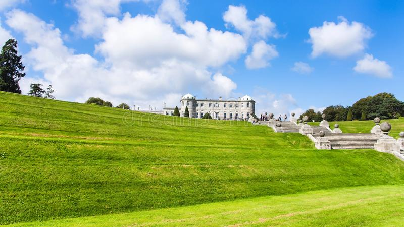 Tourists visiting Powerscourt Gardens, view on mansion from terraced lawn. Tourists visiting Powerscourt Gardens one of the most beautiful gardens in Ireland royalty free stock photography