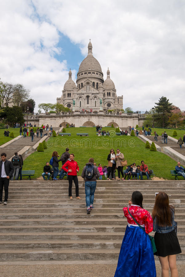 Tourists visiting the Sacre Coeur in Montmartre stock photo