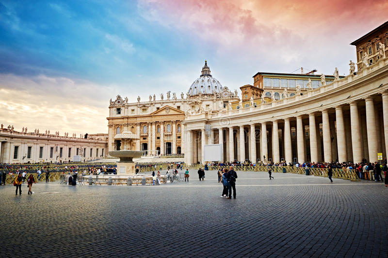 Tourists visiting the Square and the Basilica of St. Peter in Rome. VATICAN CITY, VATICAN - OCTOBER 29: Tourists visiting the Square and the Basilica of St royalty free stock photos