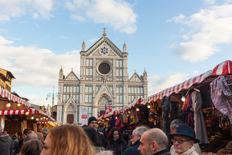 Tourists visits the christmas market in Florence royalty free stock image