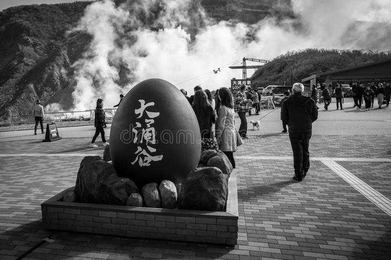 Tourists at the volcanic valley of Owakudani in Japan royalty free stock photography