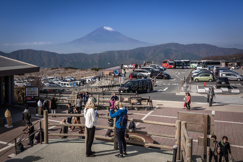 Tourists at the volcanic valley of Owakudani with Mount Fuji view royalty free stock photo