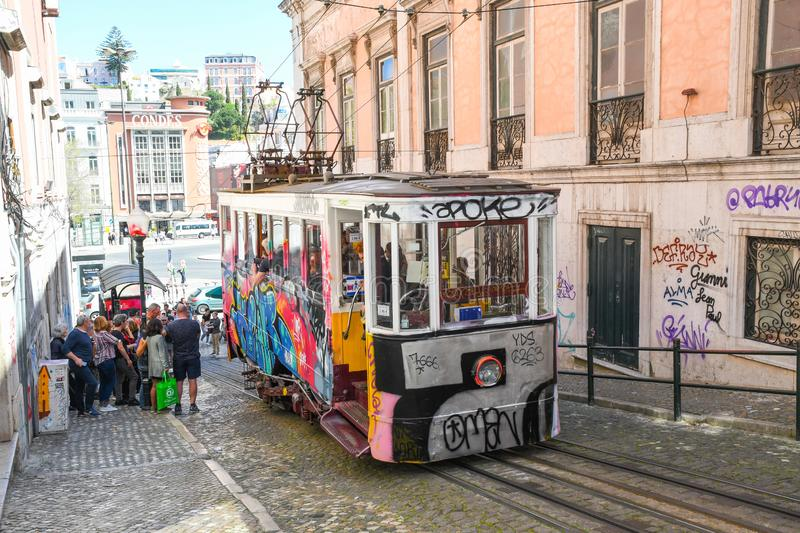 Tourists waiting for Elevador da Gloria in Lisbon. Europe. Elevador da Gloria is a very old public transport vehicle similar to tram in Lisbon. One of the most stock photo
