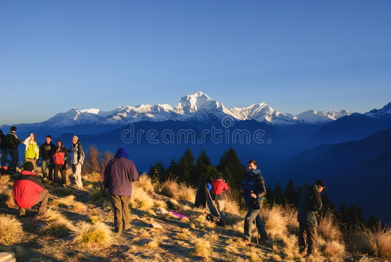 Tourists waiting sunrise at Poonhill, Annapurna circuit in Nepal royalty free stock images