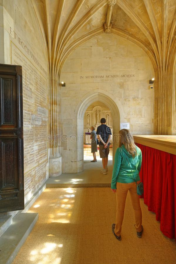 Queuing up to pray. Kings College Chapel interior. Tourists waiting to enter a sacred room in Kings College Chapel which has the world`s largest fan vault royalty free stock image