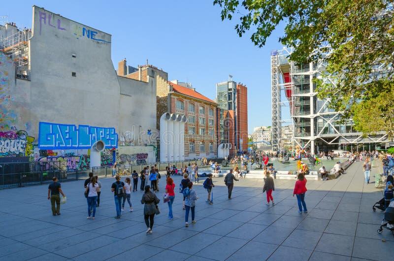 Tourists walk across Igor Stravinsky Square to modern avant-garde Stravinsky fountain Tinguely fountain, Paris, France stock photography