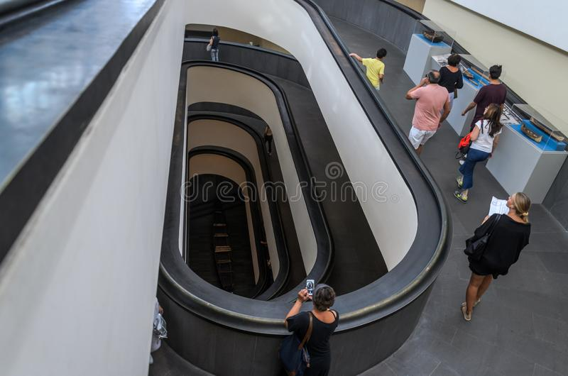 ROMA, ITALY - AUGUST 2018: Tourists walk along the ancient spiral stairs to the Vatican museums royalty free stock photography