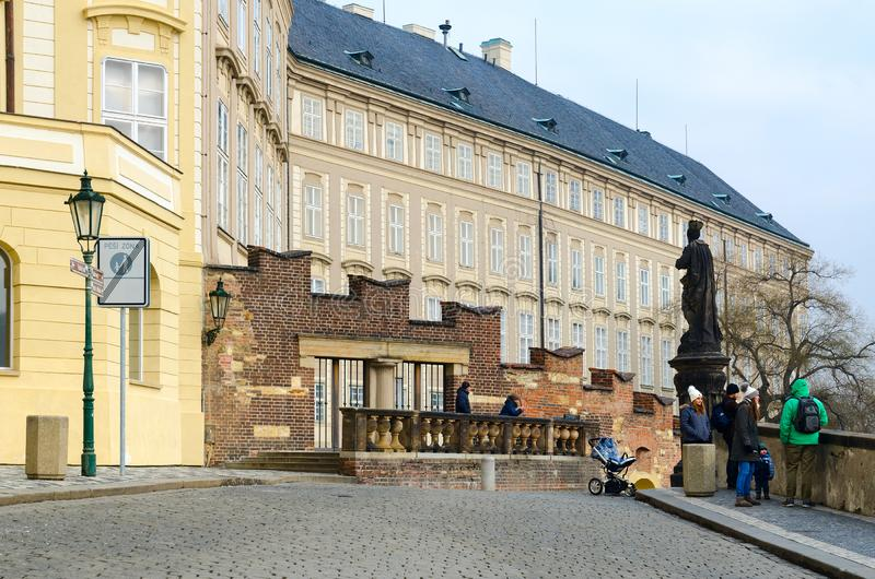 Tourists walk along Hradchanskaya Square in historic center of city, Prague, Czech Republic royalty free stock image