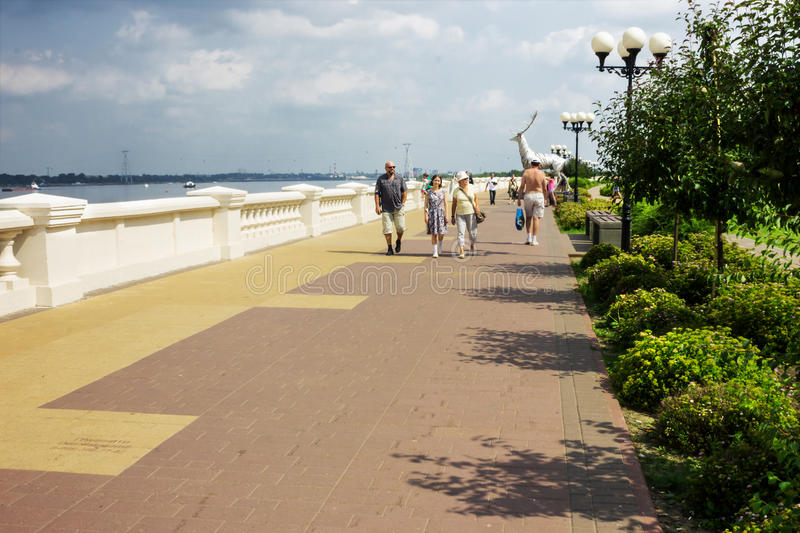 Tourists walk along the Volga embankment in Nizhny Novgorod stock photo
